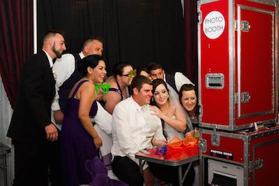 Red Mobile Photo Booth with Wedding Guests getting photographed